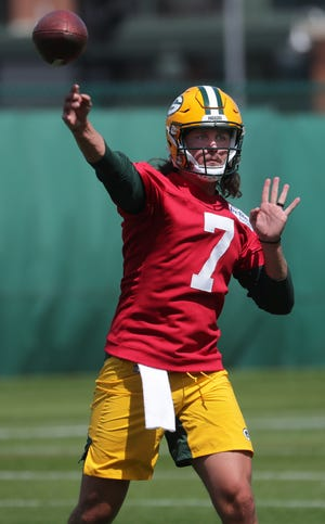 Quarterback Kurt Benkert loosens up during the first day of Green Bay Packers rookie minicamp Friday.