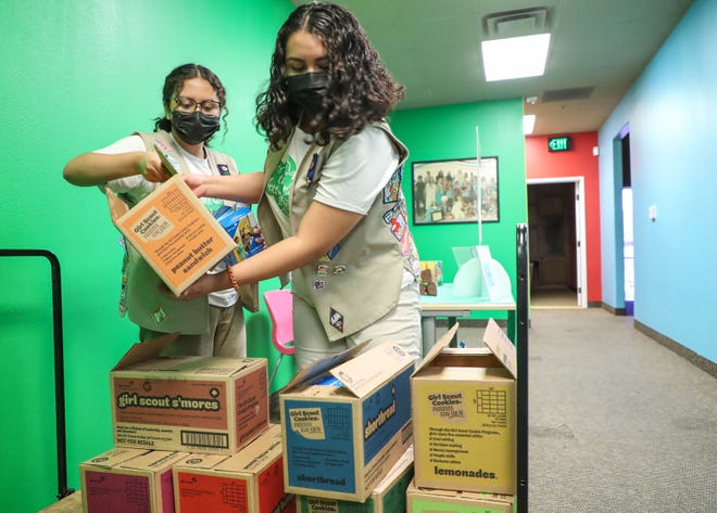 Sisters Alyssa Arzate, left, and Jeweleah Arzate from Girl Scout Troop 111 prepare their Girl Scout cookies for sale at the Palm Desert Girls Scouts Offices , May 13, 2021.