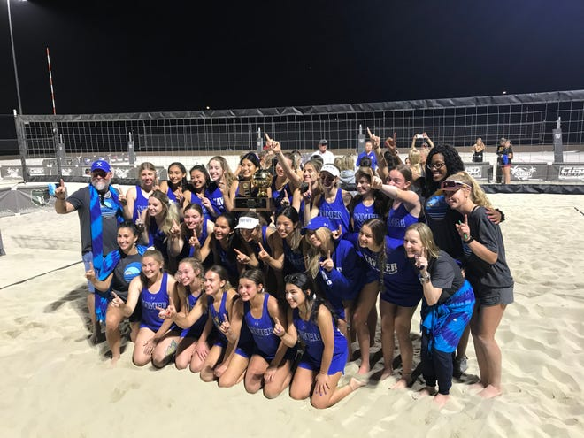 May 13, 2021; Xavier Prep holds up its eighth AIA Division I beach volleyball state championship trophy after beating Sandra Day O'Connor at Casteel High School in Queen Creek, Ariz.