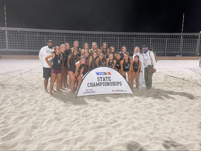 Members of the Salpointe Lancers beach volleyball team celebrate after winning the Arizona Division II state championships.