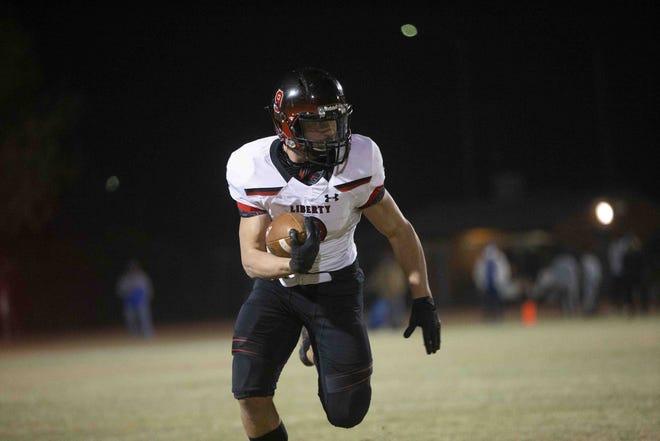 Dec. 5, 2020; Chandler, AZ, USA; Liberty's running back Zach Wallace (9) runs the ball at Chandler High School. Credit: Meg Potter/The Arizona Republic