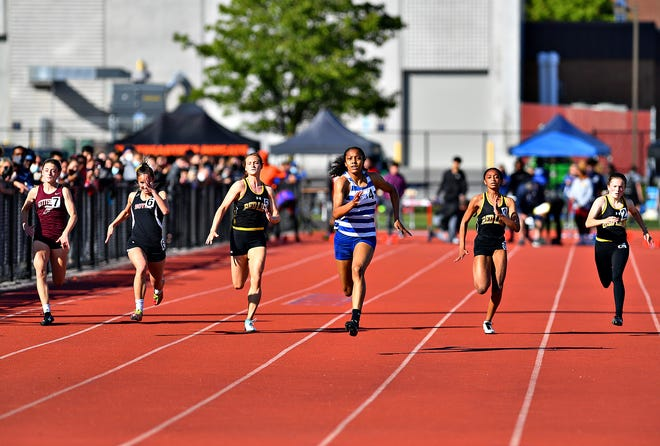 Spring Grove's Laila Campbell, third from right, would with the girls' 100-meter dash event at 12:18 during York-Adams League Track and Field Championships at New Oxford High School in Oxford Township, Adams County, Thursday, May 13, 2021. Dawn J. Sagert photo
