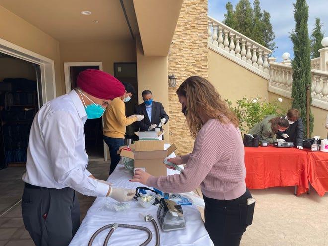 Volunteers repurposing machines to be sent to India as ventilators.