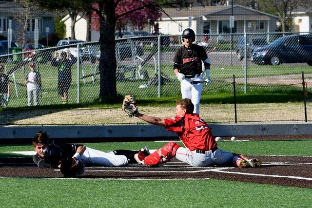 Brandon Valley catcher Carson Askdal applies the tag at home in Brookings on May 11, 2021.