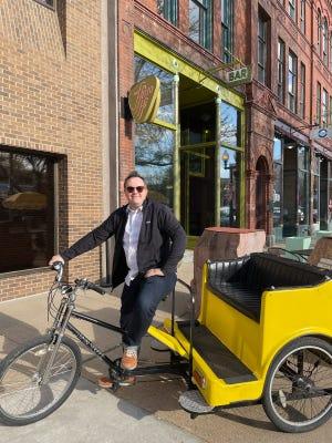 Emmett Reistroffer sits on a pedicab.