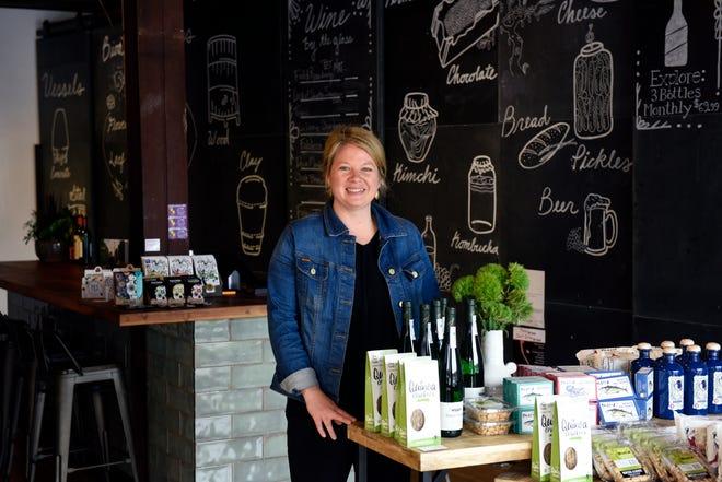 Mel Guse stands inside her new business Gist Wine Shop