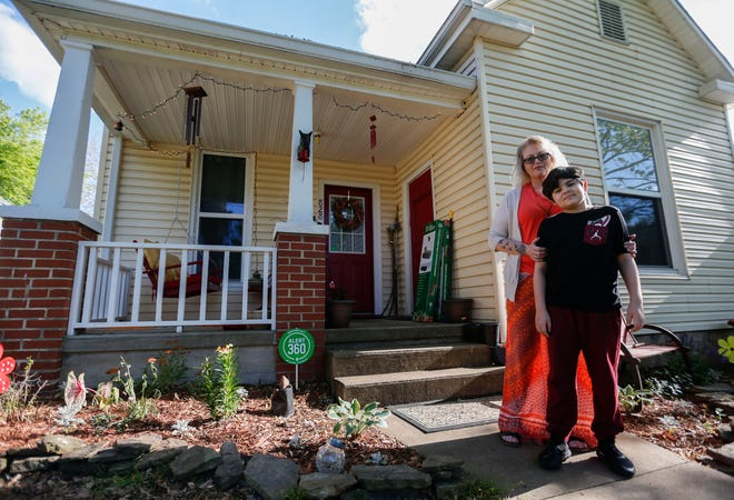 Marsha Hatfield and her son Skyler outside their home on Thursday, May 13, 2021. Hatfield took part in the Drew Lewis Foundation's Blue House Project, which helped her become a homeowner.
