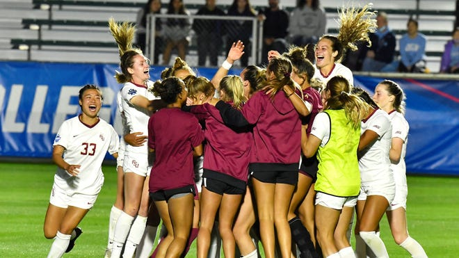 The Florida State soccer team celebrates after winning the penalty-kick shootout over Virginia to advance to the College Cup Final.