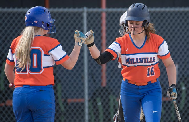 Millville's Olivia Stetler, right, is congratulated by Millville's Novalee Bybel after Stetler was batted in by Millville's Ella Gamber during the softball game between Millville and  Our Lady of Mercy Academy played at Millville Senior High School on Friday, May 14, 2021.