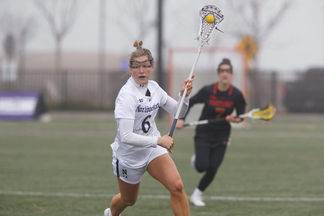 Bronxville grad Allie Berkery carries the ball for unbeaten Northwestern during its March 27, 2021 win over Maryland.