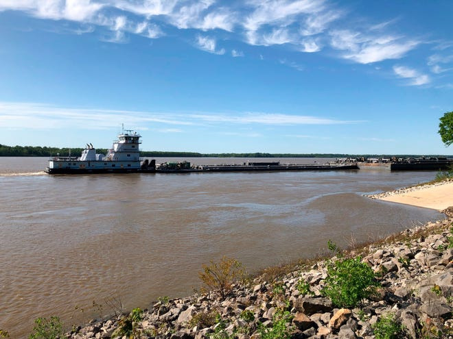 A tugboat with a barge attached sits near a boat ramp at Meeman-Shelby Forest State Park, Wednesday, May 12, 2021, in Millington, Tenn. A crack in the Interstate 40 bridge linking Tennessee and Arkansas has shut down Mississippi River traffic near Memphis, forcing tugs that are hauling barges to wait until they receive clearance that it's safe to pass under the closed bridge.