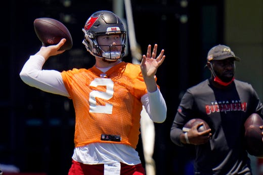 Tampa Bay Buccaneers quarterback Kyle Trask throws a pass during a Buccaneers NFL football rookie minicamp Friday, May 14, 2021, in Tampa, Fla.