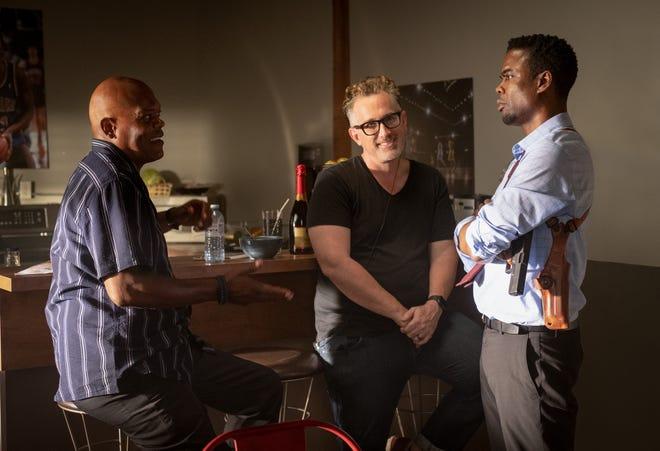 "(L-R) Samuel L. Jackson talks with director Darren Lynn Bousman  and Chris Rock on the set of ""Spiral."""