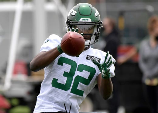 New York Jets fourth-round draft pick Michael Carter works out during NFL football rookie camp, Friday, May 7, 2021, in Florham Park, N.J.