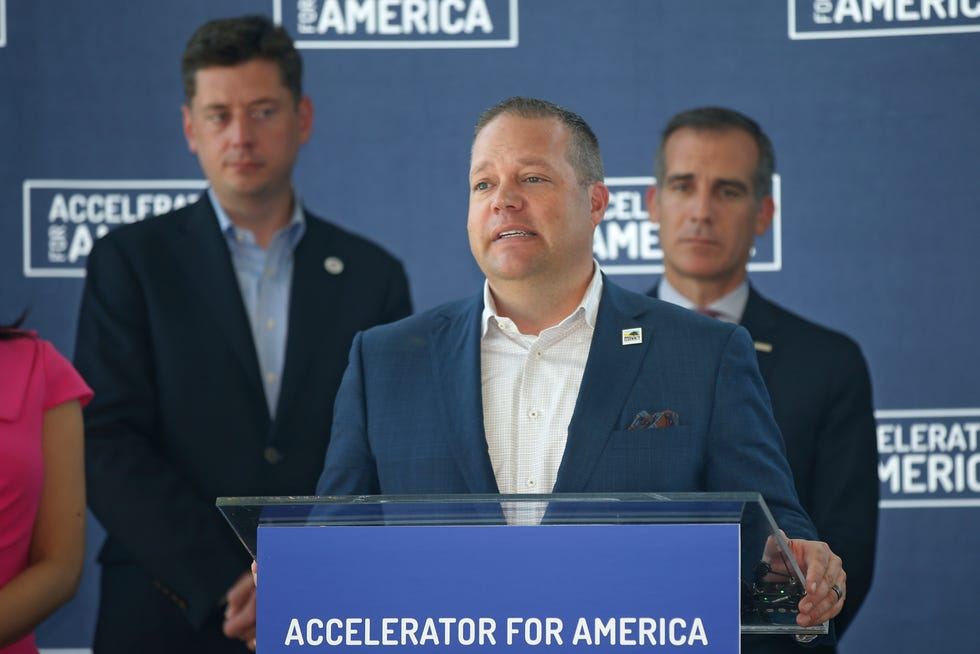 Rochester Hills, Mich. Mayor Bryan Barnett, center, speaks as Oklahoma City Mayor David Holt, left, and Los Angeles Mayor Eric Garcetti, right, look on, during a news conference Friday, Sept. 6, 2019, following an Accelerator for America meeting in Oklahoma City. (AP Photo/Sue Ogrocki)