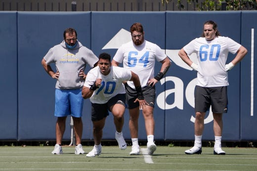 Los Angeles Chargers offensive tackle Rashawn Slater (70) runs a drill as Brenden Jaimes (64) and Kyle Spalding (60) watch during an NFL football rookie minicamp in Costa Mesa, Calif., Friday, May 14, 2021.