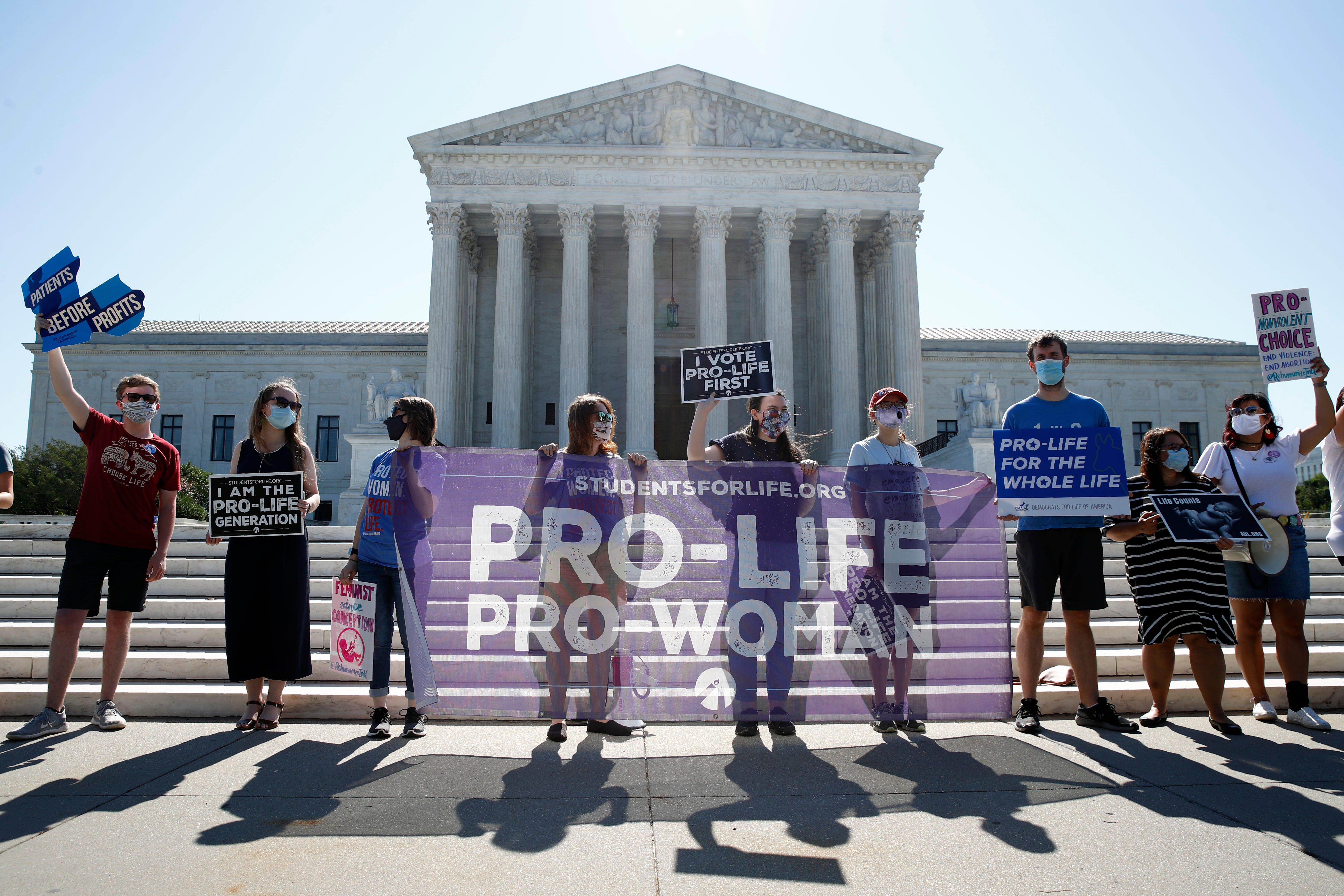 Anti-abortion protesters wait outside the Supreme Court for a decision on a Louisiana case, Russo v. June Medical Services, on June 29, 2020.