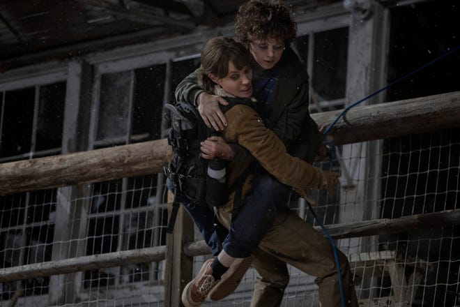 """Smokejumper Hannah (Angelina Jolie) and young Connor (Finn Little) encounter a number of dangerous situations in """"Those Who Wish Me Dead."""""""