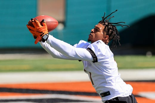 Cincinnati Bengals wide receiver Ja'Marr Chase makes a catch during an NFL football rookie minicamp in Cincinnati, Friday, May 14, 2021.