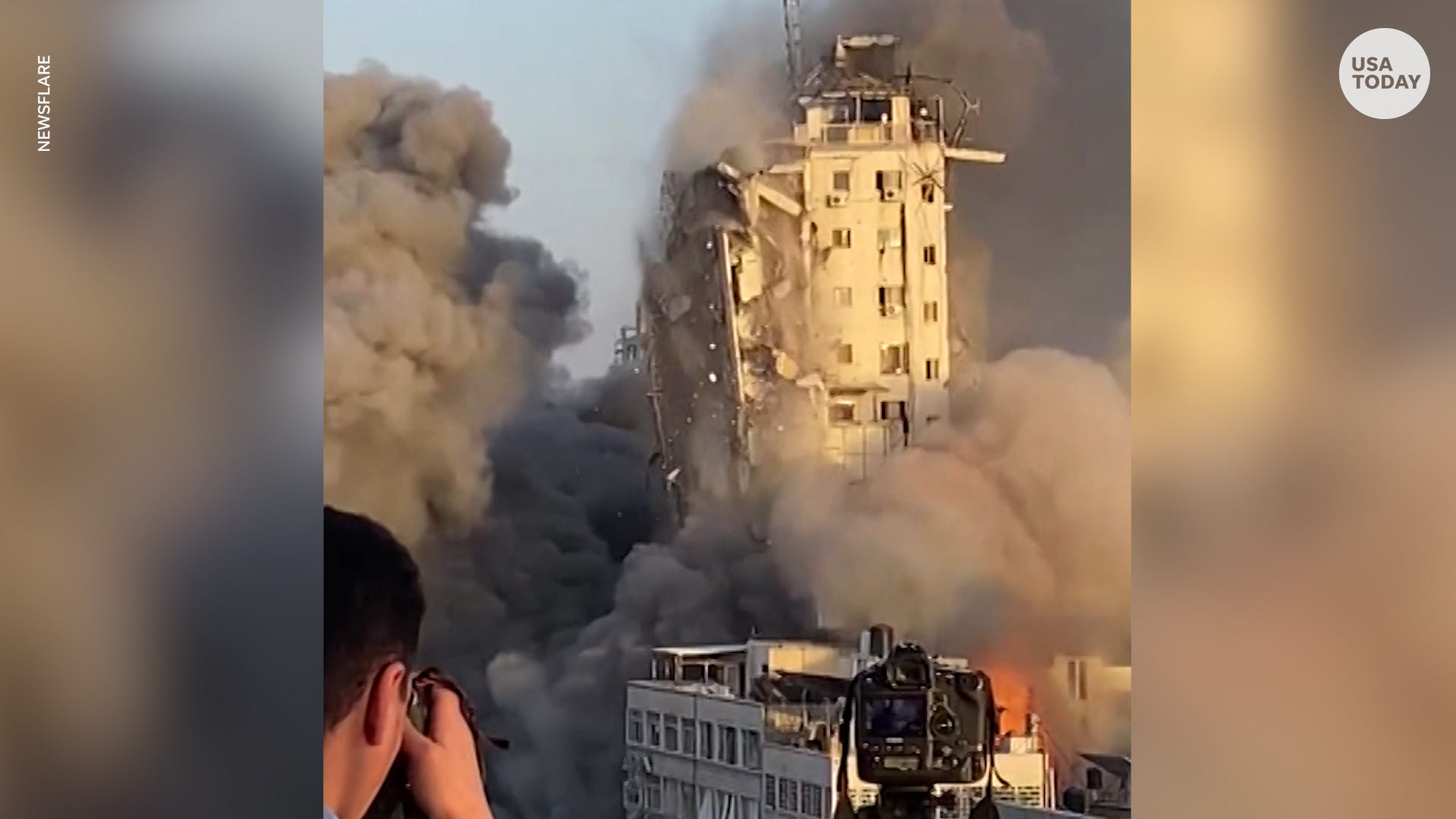 Fearless photographer captures moment missile attack takes down Gaza tower