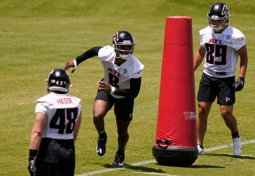 Atlanta Falcons tight end Kyle Pitts, center, runs drills during an NFL football rookie minicamp on Friday, May 14, 2021, in Flowery Branch, Ga.