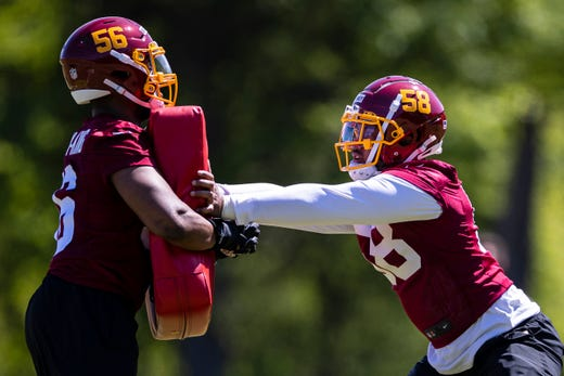 Washington Football Team defensive end Shaka Toney (58) and defensive end William Bradley-King (56) participate in drills during rookie minicamp at Inova Sports Performance Center.