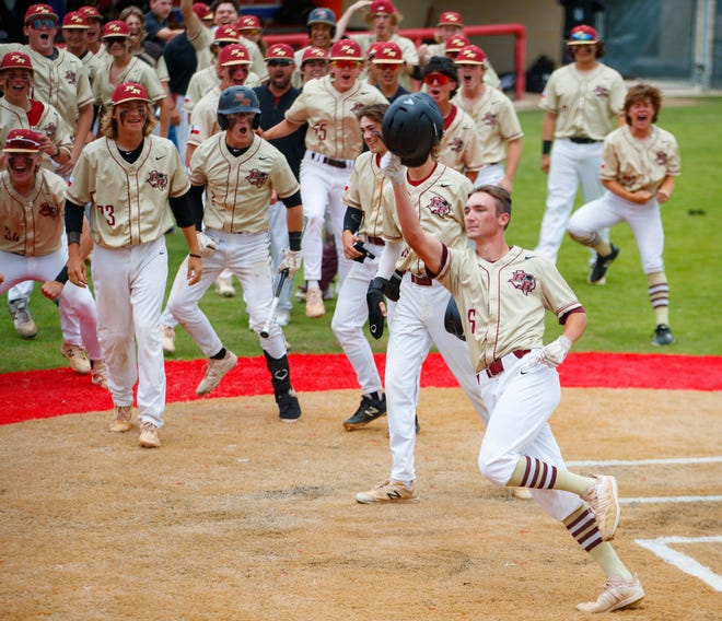 Rouse's Jake Alepa crosses home plate after a grand slam against Floresville in the second inning of a Class 5A area-round playoff Saturday at Hays High School. Rouse won 11-5 to advance to the third round against Cedar Park.