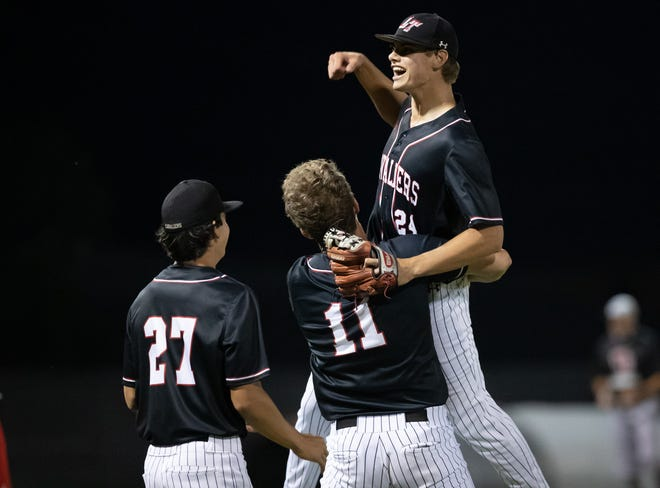 Lake Travis senior pitcher Ethan Roark celebrates his complete-game shutout after the 6-0 win over San Antonio Churchill Friday at Lake Travis High School that secured the Cavs a sweep in the Class 6A Region IV-area round series.