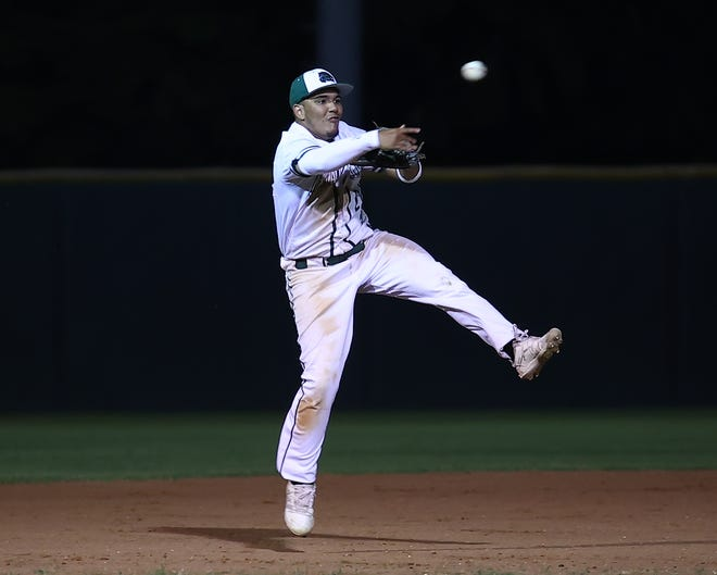 Cedar Park third baseman Julian Swift collects the final out by throwing out the Medina Valley runner in the top of the seventh inning as the Timberwolves won game two Friday at Cedar Park High School 8-3 to advance in the Class 5A playoffs.