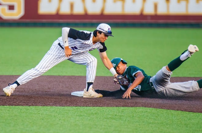 Cedar Ridge's Daniel Patterson tags Reagan's CJ Hall for the out on the slide to second base during the second inning at the Class 6A baseball area-round playoff Friday at Dripping Springs High School. Reagan won the game 6-1 to advance to the third round.