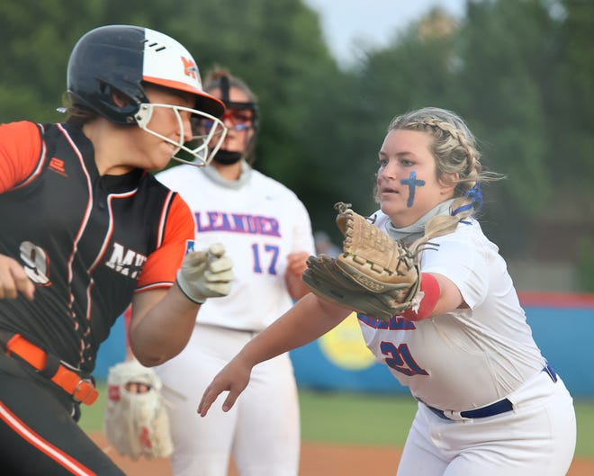 Leander's Lauren Tetreault tags out a Medina Valley base runner in a playoff game Friday at Leander High School. The No. 1 Lions defeated Medina Valley 2-0 in the first game of a best-of-three series.