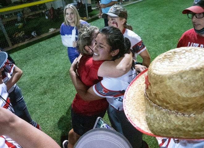 Bowie head coach Liz Wissel, left, hugs pitcher Emma Solis after the 3-1 victory Friday to eliminate Lake Travis.