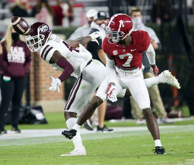 Oct 31, 2020; Tuscaloosa, Alabama, USA;  Alabama defensive back Brandon Turnage (7) breaks up a pass intended for Mississippi State wide receiver Malik Heath (4) at Bryant-Denny Stadium during the second half of Alabama's 41-0 win over Mississippi State. Gary Cosby Jr/The Tuscaloosa News via USA TODAY Sports