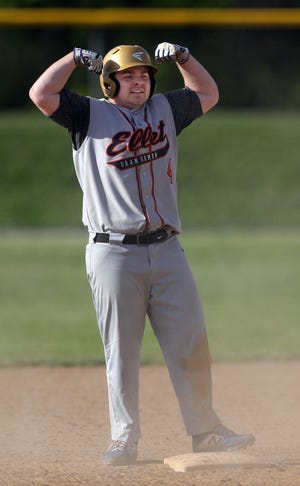 Ellet's Ethan Rine flexes at second base during a 7-2 win over Woodridge on Friday. [Jeff Lange/Beacon Journal]