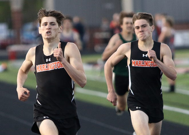 Marligton's Brenden Hamilton, left, and Liam Blake during the boys 400-meter dash at the 2021 Eastern Buckeye Conference Championship held at Canton South High School Friday, May 14, 2021.