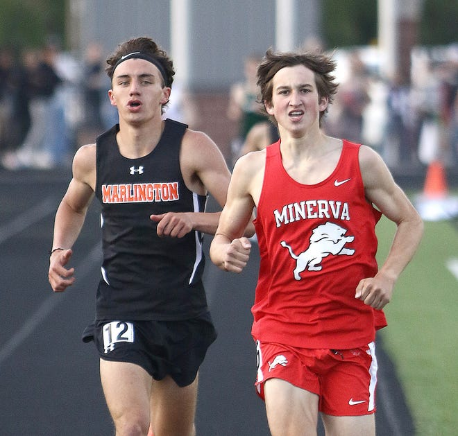 Minerva's Connor Shingleton (right) and Marlington's Noah Graham battle for the league title in the boys 1,600-meter run at this year's Eastern Buckeye Conference Championships. Shingleton won the race. On Saturday, he advanced to the state meet in the 800 and 1,600.