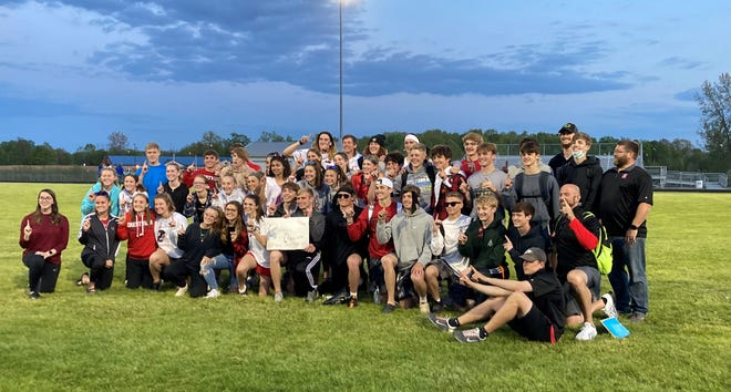 Crestview's boys and girls track and field teams pose for a picture after finishing first at the Firelands Conference Championships Friday at Mapleton High School.