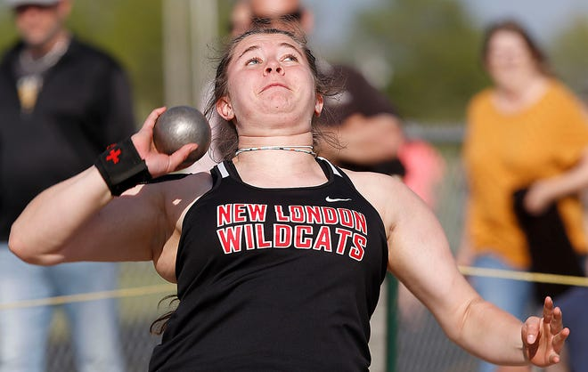 New London High School's Kaitlyn Gum competes in the shot put at the Firelands Conference Track meet Friday, May 14, 2021 at Mapleton High School. TOM E. PUSKAR/TIMES-GAZETTE.COM