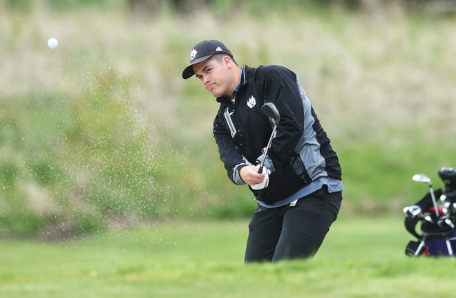 Nevada's Caden Jones chips the ball from a bunker onto the 15th hole during the Class 3A boys' sectional golf meet at the Ames Golf and Country Club Friday in Ames. Jones advanced to districts with a fifth-place score of 77.