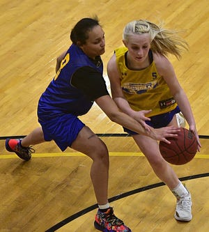 Rochester's Alexis Robison, left, reaches in on OLSH's Grace Bradley during the 2021 Roundball Classic-All Stars, girls Class 2A/City League vs. Class 3A/Class 1A game Friday in Metheny Fieldhouse at Geneva College. [Lucy Schaly/For BCT]