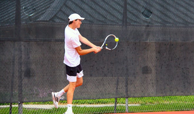 El Dorado Junior Hayden Greene returns a serve in a match on Saturday, May 15 at the Kossover Tennis Center in Topeka, Kansas. Greene finished seventh in singles.