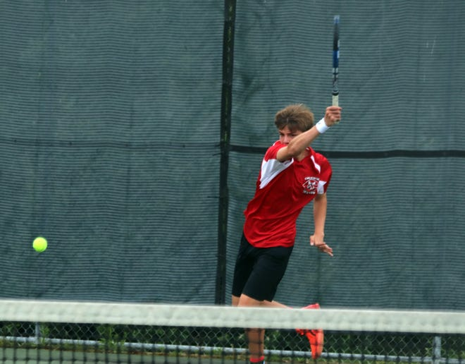 Chace Corbin, Chillicothe (Mo.) HS tennis Hornets junior, watches the flight of the baseline forehand he's just sent toward his opponent during Friday's state-qualifying Class 1 sectional singles match on Chillicothe's Daryl Danner Memorial Park courts. Corbin won the match against Matt Goodridge of Maryville 6-2, 6-3 to advance to the upcoming state tournament at springfield.