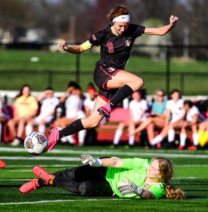 Chillicothe (Mo.) HS soccer Lady Hornets junior forward Lucy Reeter leaps over the sliding St. Joseph: Benton goalkeeper to avoid a collision as both raced for a ball in the BHS penalty area during the teams' April 5 match in Chillicothe. On Friday, May 14, Reeter hurdled Lindy Saunders into first place on CHS' single-season goals chart with her 27th of the season in a 5-1 loss at Maryville.