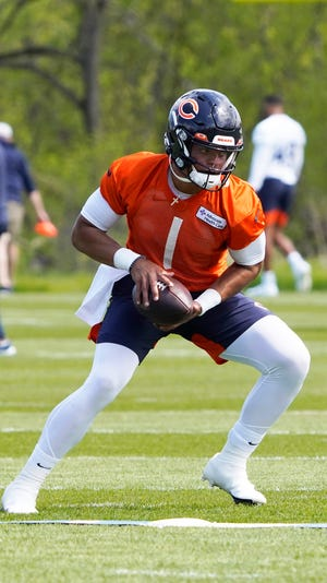 Chicago Bears quarterback Justin Fields practices during rookie minicamp on Friday. The former Ohio State star will compete with veterans Andy Dalton and Nick Foles for the starting job.