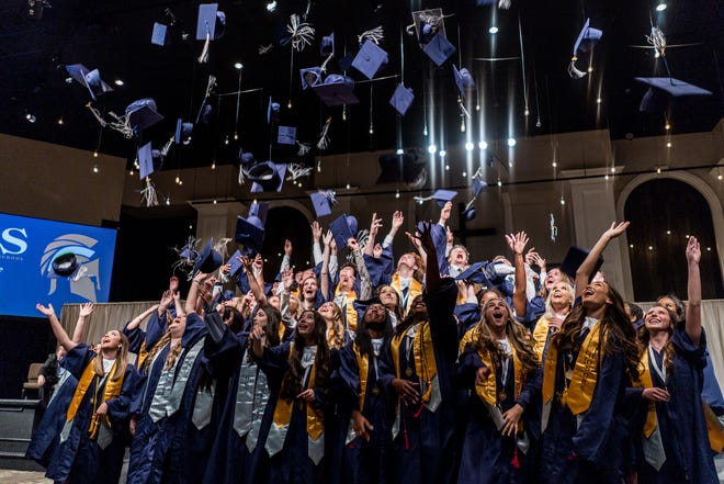 2021 Houma Christian School graduates toss their caps at the end of this year's ceremony.
