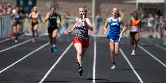 Norwayne's Lacy Hess (center) anchors the winning 4x200 meter event.