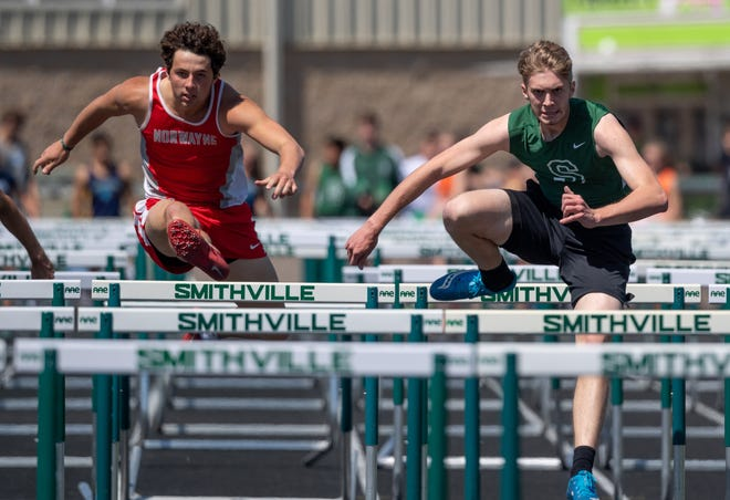 Norwayne's Nic Graham (left) and Smithville's Alex Taylor battle in the boys 110 hurdles.