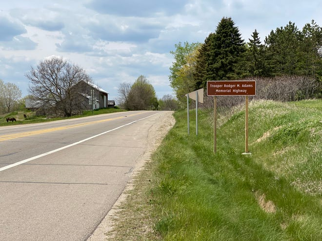 U.S. 12 between M-52 and Monagan Highway was dedicated Friday as the Trooper Rodger M. Adams Memorial Highway. Adams died May 14, 1971, in a crash about 3.5 miles west of where the memorial sign near M-52 can be seen.