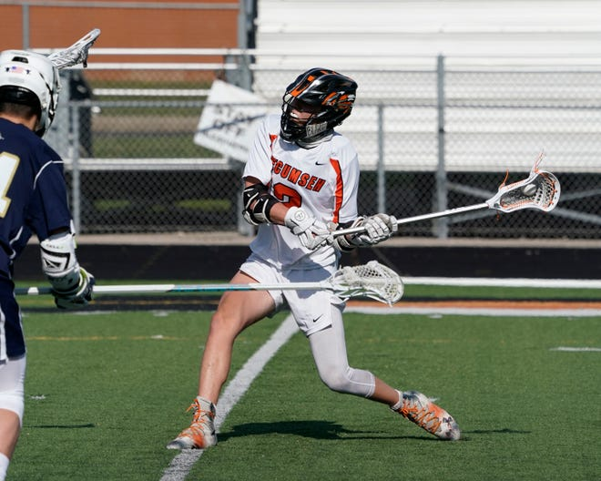 Tecumseh's Devin Macomber shoots during Friday's game against Chelsea.