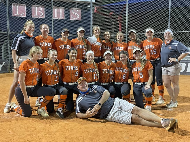 University's softball team, coached by Kenny Walters (front), reached the Final Four for the first time Friday with a 3-0 win at Lake Brantley.